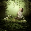 Stock Photo: Little girl in magic forest