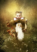 The little girl in the magic forest — Stock Photo