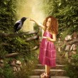 The girl and the little raven — Stock Photo