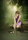Girl and duck — Stock Photo