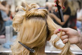 Hairstylist combing hair — Stock Photo