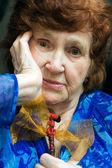 Portrait of strange elderly lady — Stock Photo