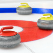 Group of curling rocks on ice — Stock Photo