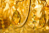 Beautiful yellow chandelier — Stock Photo
