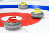 Group of curling rocks on ice — Foto Stock