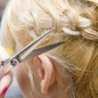 Hairstylist scissor hair - Stock Photo