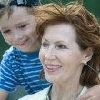Smiling grandmother with grandson — Stock Photo