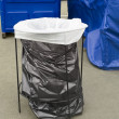 Disposable plastic bags in trash can — Stock Photo