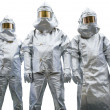 Three workers in protective clothing — Stock Photo #13876604