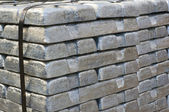 Stack of raw silvery ingots — Stock Photo