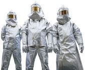 Three workers in protective clothing — Stock Photo