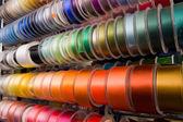 Multi-coloured ribbons on bobbins — Stock Photo