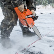 Worker carving out ice on lake — Stock Photo