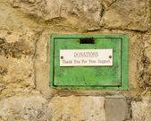 Old Green Donations Box Set in Stone Wall. — Stock Photo
