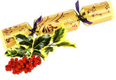 Ivy, red winter berries and golden, ornate Christmas cracker — Stock Photo