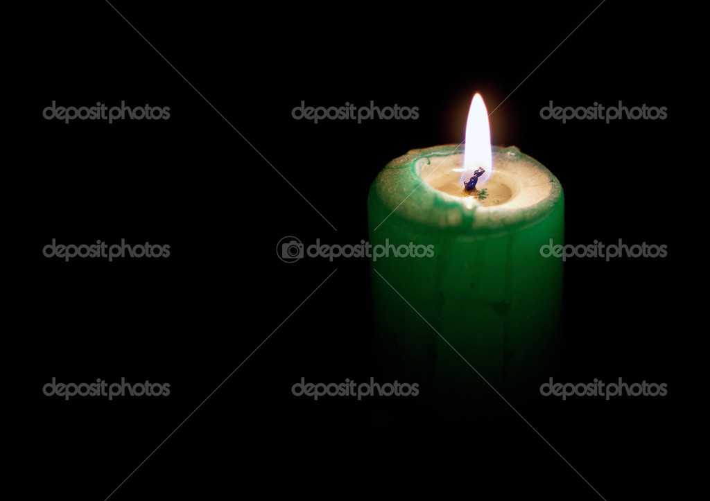 A candle shining on a black background — Stock Photo #12818556