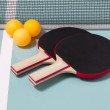Table tennis rackets and balls — Stock Photo