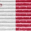 Malta flag on an old brick wall — Stock Photo