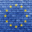 European Union flag on a brick wall - Stock Photo