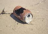 Oxidized tin laid on the sand — Stock Photo