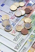 Euro banknotes and coins — Foto Stock