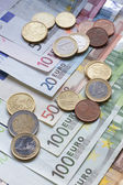 Euro banknotes and coins — Stockfoto