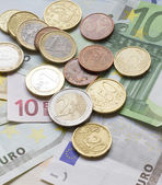 Euro banknotes and coins — 图库照片