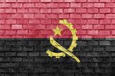 Angola flag on a brick wall — Stock Photo