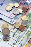 Euro banknotes and coins — Foto de Stock