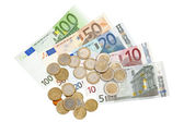 Euro banknotes and coins isolated on white background — Stock Photo