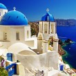 White-blue Santorini - view of caldera with churches — Stock Photo