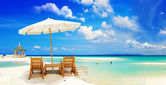 View of nice tropical empty sandy beach with umbrella and beach chair — Stok fotoğraf