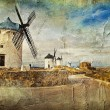 Windmills of Spain - picture in painting style - Stock Photo