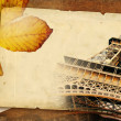 图库照片: Autumn in Paris - retro background with old page