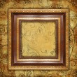 Stock Photo: Carved gilded frame over old wallpaper