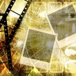 Retro grunge background with film strips and instant photo frames - Stock Photo