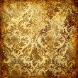 Vintage decorative background in grunge style with golden patterns — Stock Photo