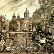 Beautiful Amsterdam canals - picture in retro style — Stock Photo #12768107