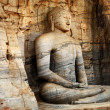 Unique monolith Buddha statue in Polonnaruwa temple - medieval capital of Ceylon,,UNESCO World Heritage Site - Stock Photo
