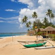 Tropical solitude - beach scene with boat. Sri lanka - Stock Photo