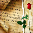 Romantic vintage background with note pages and rose - Stock Photo