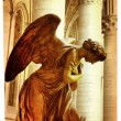 Praying angel - artistic picture in retro style - Stock Photo