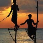 Amazing sunset in Sri lanka with traditional stick-fishermen — Stock Photo