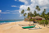Tropical solitude - beach scene with boat. Sri lanka — Stock Photo