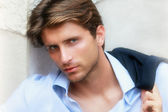 Portrait of young man with impressing blue eyes — Stock Photo