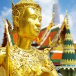 Grand palace in Bangkok with golden statue - Stock Photo