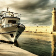 Lighthouse and boat in old port of Rethimno- artistic toned picture — Stock Photo