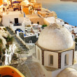 Oia village at sunset, Santorini island, Greece — Stock Photo