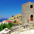 Stock Photo: Beautiful Greece - pictorial view with windmil of Symi island