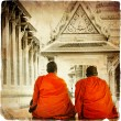 Two monks in Thai temple - artistic toned picture in retro style - Stock Photo